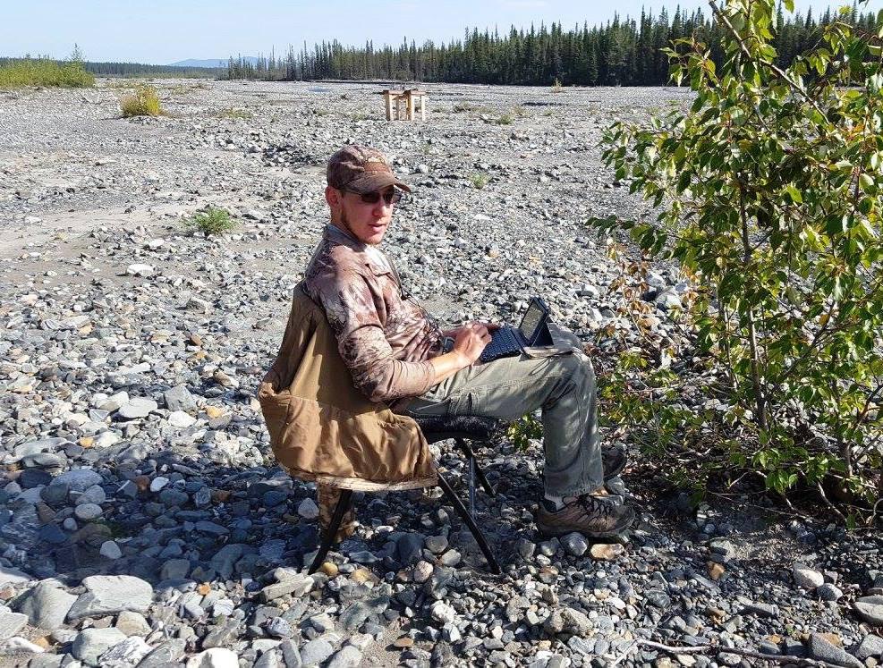 Joshua C Chadd working on his next Book in the Alaskan 'bush'