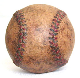 This great vintage baseball features red and blue stitching. It displays beautifully with an ideal patina!