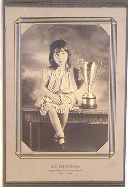 1930 Photograph of Young Girl Holding Large Loving Cup Trophy
