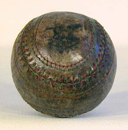 """1910-20's Green and Red Stitched """"Double-Seam"""" Baseball made by the Draper and Maynard Sporting Goods Company. This is the very first of this style baseball that we have ever seen! The stitching is complete and tight, and the overall condition is excellent with a nice D&M logo."""