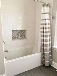 Floor - 12x24 Grey Modern Porcelain, Walls - 3x6 Ice White, Niche - 1/2x1 Bari Silk Glass
