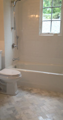 Floor - 3x6 Honed Stauary Marble, Walls - 3x6 Ice White Ceramic Tile