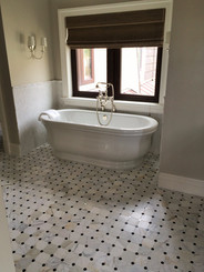 Floor - Orbit Honed Calacatta with Polished Tulip Black Dot Mosaic, Walls - Heavy Rain Calacatta Mos