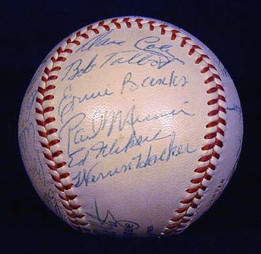 This is a 1954 Chicago Cubs Team Signed Baseball with signatures of Ernie Banks, Joe Garagiola, Ralph Kiner and 21 additional members of the 1954 Chicago Cubs baseball team. The autographs are on a Spalding Official National League baseball. The president at the time was Warren Giles. The ball still remains very white and the signatures are extremely bold. There is not much that could make this ball better, it is an outstanding example!