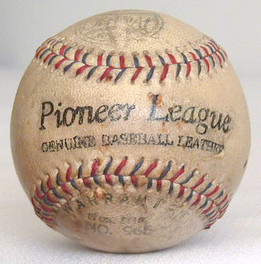 This red and blue stitched baseball shows modest use with very nice markings. A great item for your antique baseball display, EX-MT!