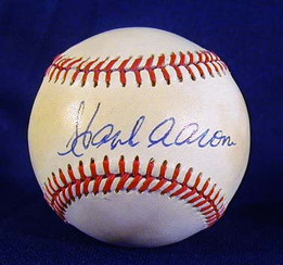 """This is a Hank Aaron Single Signed Baseball. This fine vintage baseball was autographed by The REAL Home Run King, Hank Aaron. Long before steroids and other """"performance enhancing drugs"""" this great slugger won the crown from the legendary Babe Ruth. The autograph remains dark and bold on a Rawlings - Bill White, Official National League Baseball. The condition is solid NR-MT to MINT!"""