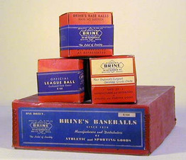 """1910-20's Brine Baseballs and Case Box. This is a fantastic grouping of antique baseballs including the original case box which housed the original dozen. Made by the James W. Brine Company the baseballs were the """"Official League Ball"""" models. Each of the vintage baseballs remains in its original unopened box with the paper seal intact."""
