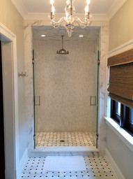 Floor - Orbit Honed Calacatta with Polished Tulip Black Dot Mosaic, Shower Wall - Heavy Rain Calacat