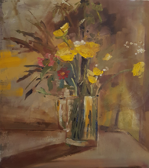 Yellow flowers in a jug