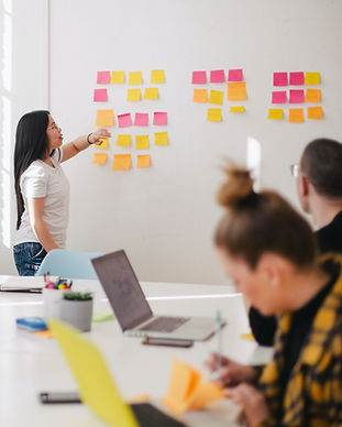 woman placing sticky notes on wall_edite