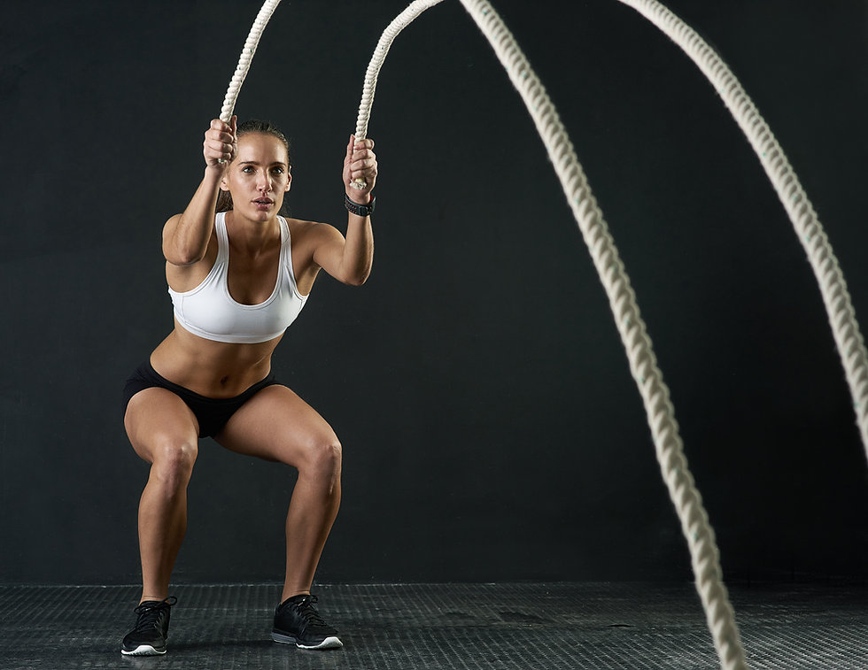 Female exercising with ropes at the best local gym melbourne