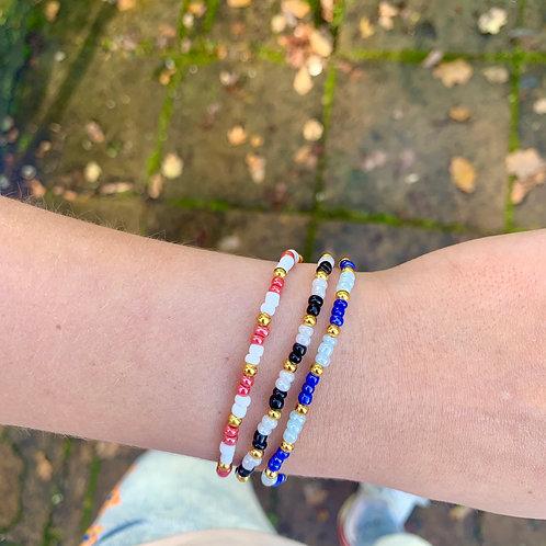 Pink-white-gold armbandje