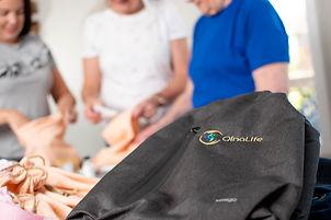 OlnaLife volunteers filling bags
