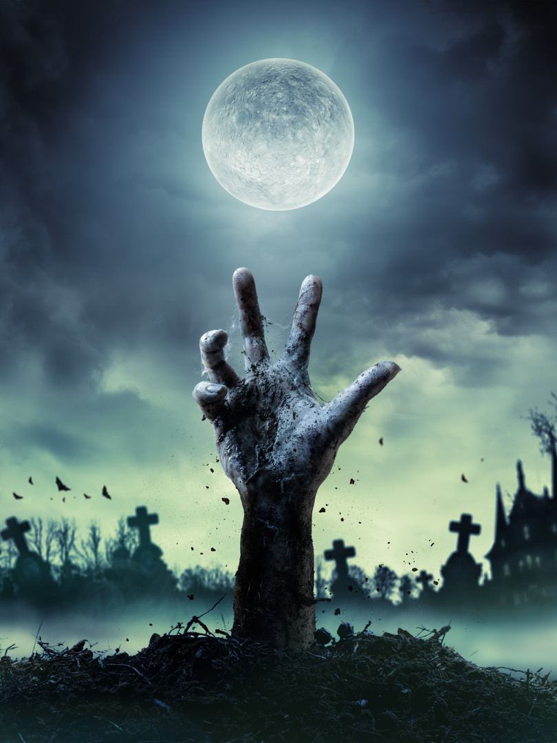 Zombie Hand Rising Out Of A Grave .jpg