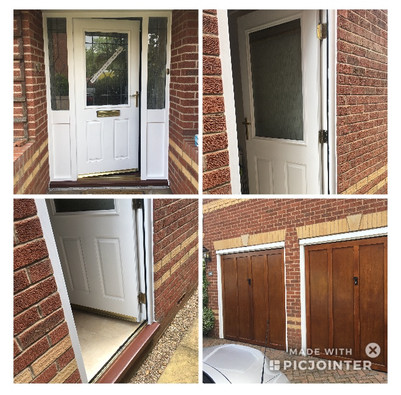 Repaired and painted wooden doors and garage surrounds