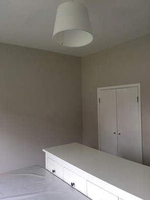 """Painted """"skimming stones"""" on walls, """"All White"""" on wood and ceiling"""