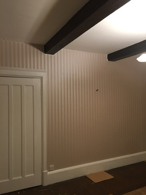 A new lick of paint on the ceiling, woodwork and radiators with new wallpaper on the walls
