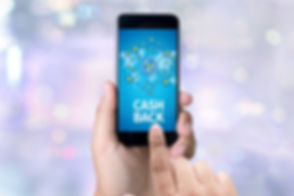 CASH BACK person holding a smartphone on