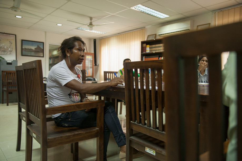 In a meeting at the Provedoria dos Direitos Humanos e Justiça (The Office of the Ombudsman for Human Rights and Justice), Romi Aty listen the Ombudsman Dr. Silverio Pinto Baptista speaking, while other LGBT members and of the PDHJ staff are in the same meeting. The PDHJ office has the role to protect and promote topics related to human rights. Recently, with the increase of the LGBT community in East-Timor, the ombudsman showed concern about stories related to discrimination and violence, so the office organizes meetings and events that are aimed to address those issues. People like Aty, which is one of the LGBT leaders and represents CODIVA Foundation, are currently present in these meetings.