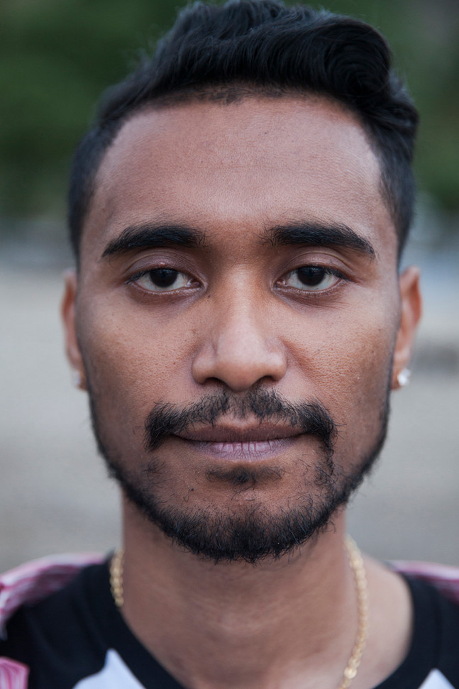 """Natalino Guterres, 28, poses for a portrait. As someone who grew up with a more feminine character, Guterres felt alone in the Timorese society. He said his parents never discriminated him, although they pressured him to change. """"I was always told that if I keep being the way I was, I wouldn't go far in life,"""" Guterres said. He left East-Timor to study abroad and exposed himself to more progressive societies. """"I fully realized: 'This is who I am; I shouldn't hate myself; [and] I shouldn't hide."""" Nowadays, Guterres is one of the main leaders within the Timorese LGBT community. He runs Hatutan, a group who promotes social inclusion, and he's the main person behind the Gay Pride."""