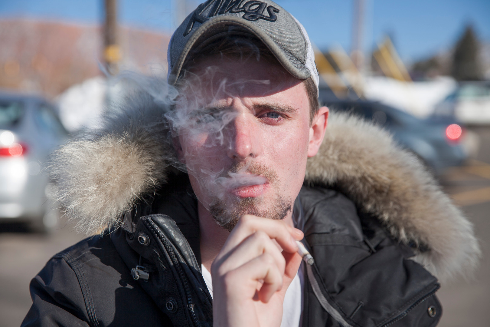 French student Geoffrey Abadie posing for a portrait while smoking a cigarette. Live in Utah is sometimes a challenge for most of the international community. The Utahan culture is highly influenced by the Mormon Church, which makes the state have strong restrictions to alcohol, tobacco, drugs, and other aspects of the social like that in many other American cities represent a normal curiosity for students. © February 2016