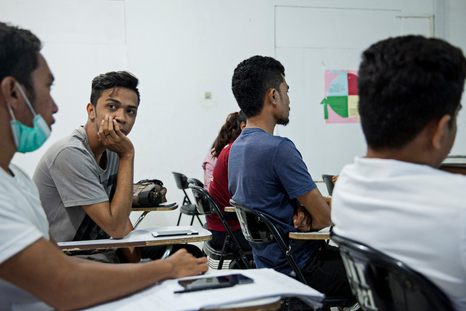 Domingos Barros, who assumes himself as gay, hears a classmate during a class at Dili Institute of Technology. As a LGBT member in East-Timor, Barros went through a difficult childhood, suffering from discrimination and violence at school. However, Barros said, the university is one of the two places (the other one is the model agency) where he feels safe, because other students understand his personality and respect his sexual orientation. Barros dreams on studying abroad in the US, where he wants to get a degree in fashion designing.