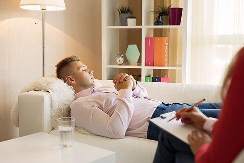 Man lying down in psychologist office.jpg
