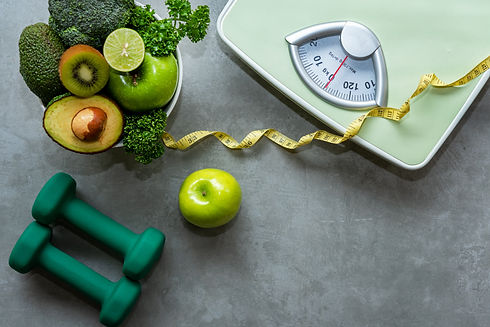 Diet and Healthy life loss weight slim Concept. Organic Green apple and Weight scale measu