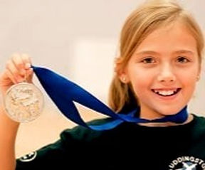 A young Jodi Smith very proud of her GOLD medal