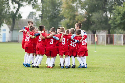 Little soccer players celebrating victor