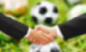 business man shake hand with football bl