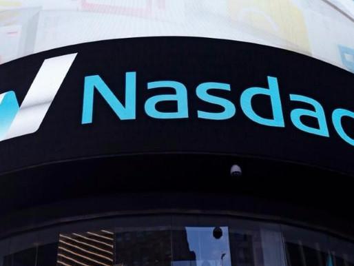 NASDAQ FALLS WITH A DROP IN TECH
