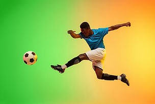 male-soccer-football-player-training-act