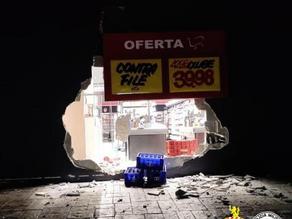 Sequestraram guincho para assaltar super mercado