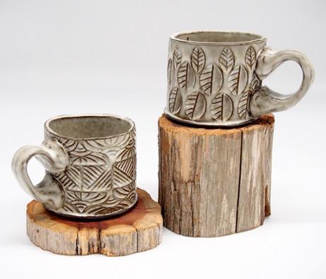 Two White Stamped Mugs
