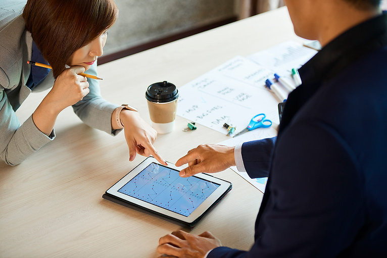 business-executives-checking-statistics-