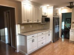 White kitchen with beige tile backsplash