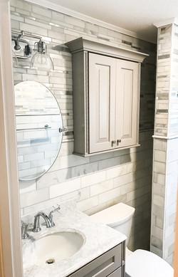 grey tile vanity, mirror and storage
