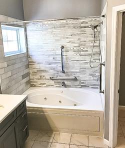 grey tile tub shower