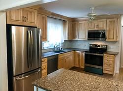 Oak kitchen with marble backsplash and granite island