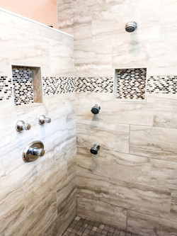 shower with glass tile border