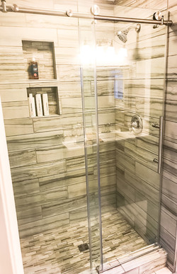 tile shower with glass doors