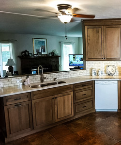 Kitchen breakfast bar area with white subway tile