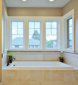 tub with wrap around windows
