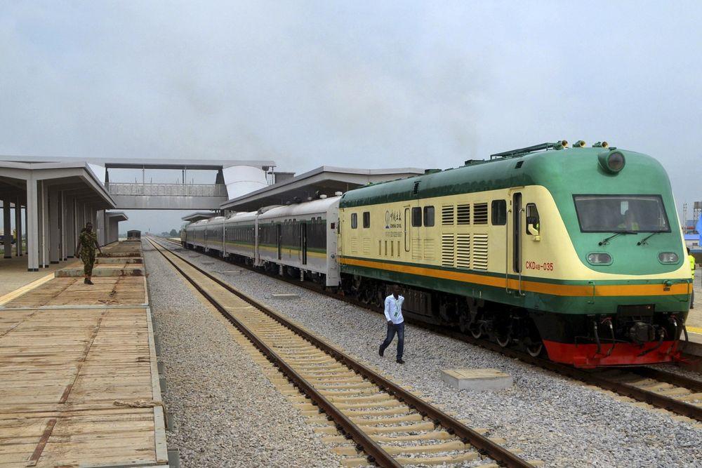 A man walks past a train in Abuja. Photographer: STRINGER/AFP