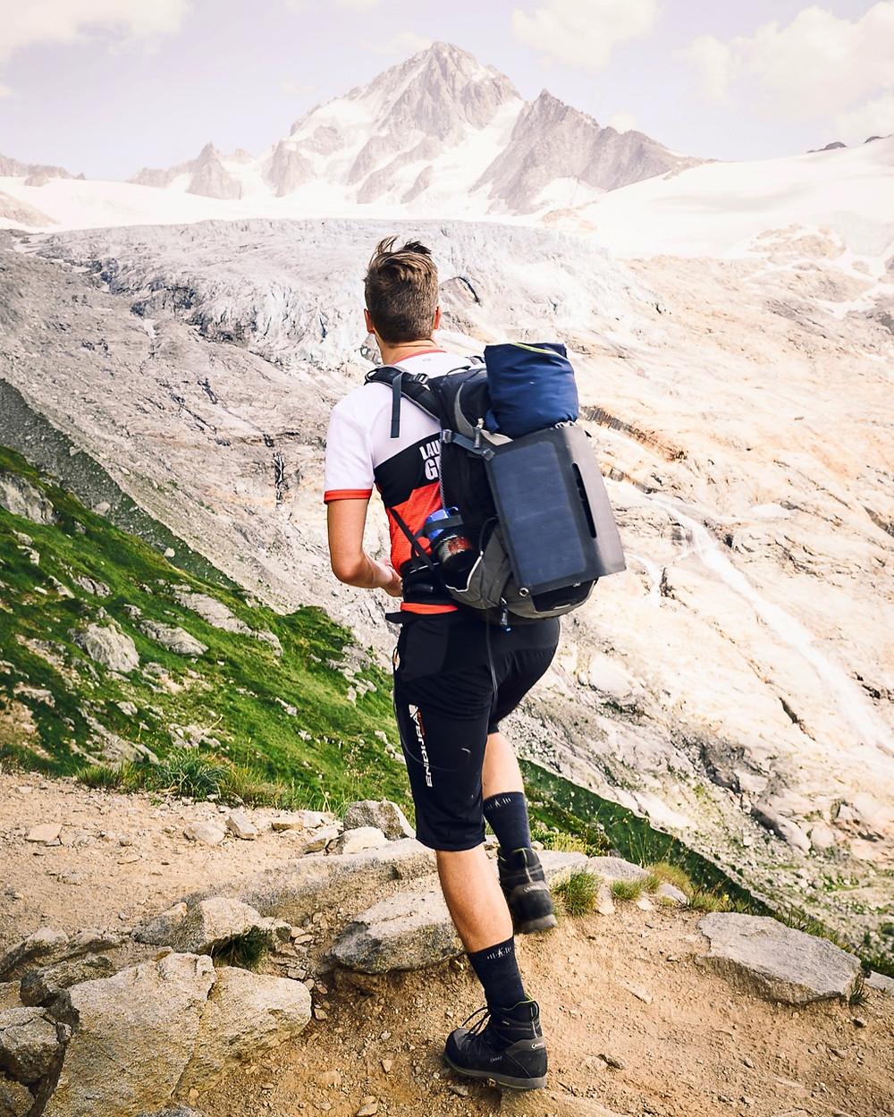 Adventure photographer @sebastianlhe hiking through the Alps with his Alto Solar Charger