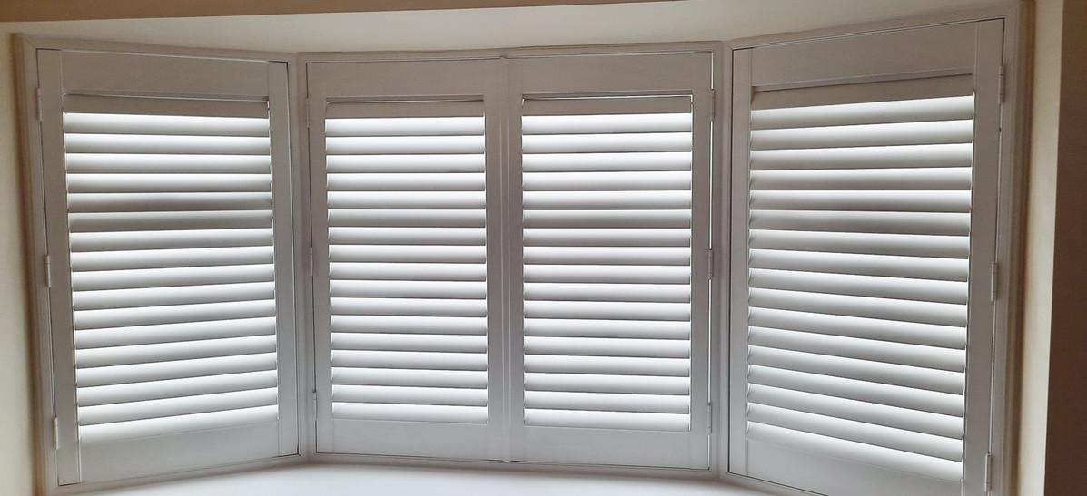 Curved bay window shutters.jpg