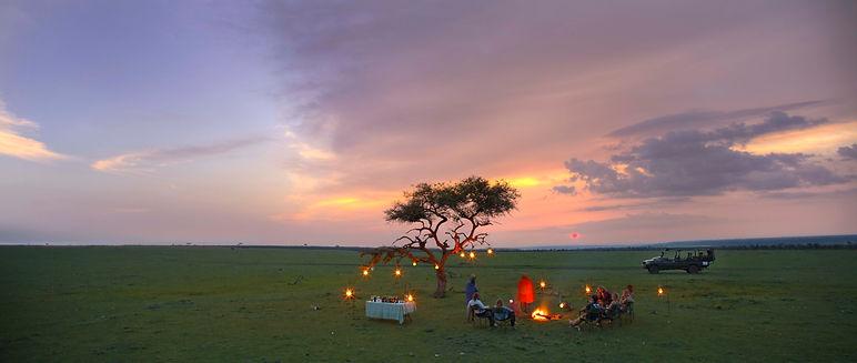 Naboisho-Camp-sundowners-in-the-conservancy.jpg