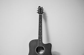 Supported music lessons guitar piano