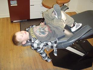 Boy sleeping in dentist's chair